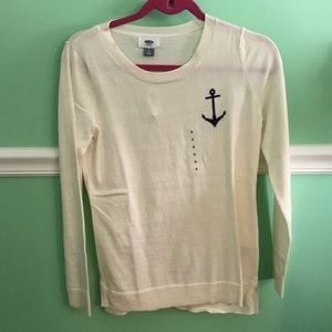 Cream sweater with navy anchor.